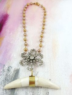 """Sweet and Savage"" - 1940's floral rhinestone brooch paired with an antique brass and horn pendant on pearl beaded chain"