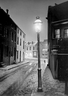 A, Aubrey Bodine  Tyson Street at Night Baltimore 1950
