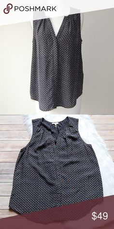 JOIE Silk Top Black and white patterned hidden button down blouse. 100% silk. Size tag was cut off but am guessing a loose small or fitted medium.   Instagram: @bringingupsuns Joie Tops Button Down Shirts