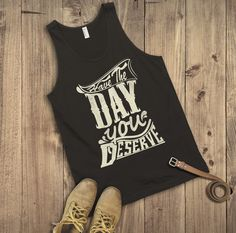 "This men's tank top is as honest as you can get. It's not always easy saying ""Have a nice day"" when you secretly wish that person has a life long butt itch and their arms are too short to reach. Well now you don't have to lie or be rude...just say 'Have the day you deserve' with this awesome typographic Tank top ;) This men's Tank top is comfortable yet fashionable and will go great with any summer outfit. It comes in a variety of colours :)"