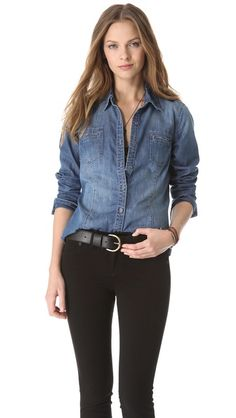 A chambray button-down blouse with a softly undone look, designed with a frayed shirttail hem and subtly worn spots. A fold-over collar and welt pockets add a crisp finish, and buttoned cuffs finish the long sleeves.