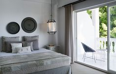 Nestled among pine trees on a hillside overlooking the Aegean, the Skiathos Bluhotel opened its doors this past summer after a thorough renovation by interior architect Afroditi Bonatsou and herAthens-based interior design studio Stones & Walls.