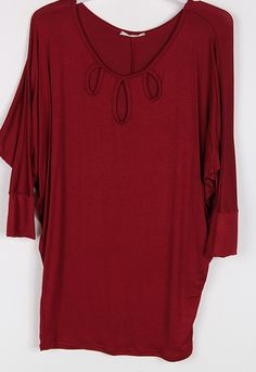 $28 SOLID JERSEY 3/4 SLEEVE TOP with three hole cut-out  96% RAYON 4% SPAN MADE IN USA