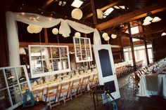 Rustic-Virginia-Vineyard-Wedding-Reception-Venue - Love the use of all the old windows and the door-turned-chalkboard!