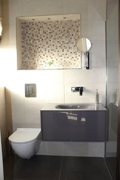 Ensuite bathroom with continuing colour scheme introduced in the use of tiles. smart and sleek. #ensuite #bathroom #tiles