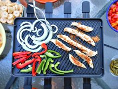 Cooking up peppers, onions, and chicken on the raclette grill for our fajitas. We had dinner right outside on the patio.