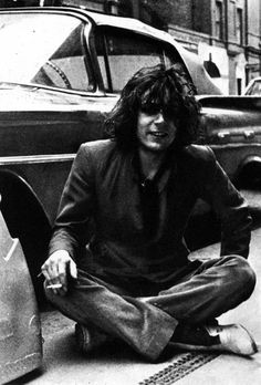 An atmospherically grainy shot of Pink Floyd's Syd Barret sitting cross legged on a New York street in the late Pink Floyd, Rock N Roll, The Ventures, Richard Wright, Roger Waters, Local Hero, Idole, My Sun And Stars, David Gilmour