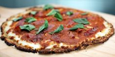 You won't believe this pizza is gluten-free. The cauliflower takes on all the flavor of a delicious pizza crust with none of the flour.