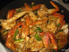 STIR FRY CURRY CRABS ==INGREDIENTS==3 cooked or raw Dungeness clean cut crack the shells, set aside  =STIR FRY SAUCE= 1/2 can coconut milk, 2 T red curry paste, 2 T sugar, 2 T oyster sauce, 2 T fish sauce, 1/2 t Chinese 5 spices, =Mix everything in a bowl set aside=  1/2 white onion slice, 2 green onions cut to 1 inch, 1/4c thinly ginger, 1 Jalapeño, 2 garlic cloves mince, 2 shallots mince, 3 T of vegetable oil for stir fry   ===============