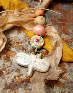 Thesehand picked, love and earth tone, artisan made ceramic beads are hand formed, hand glazedand an original design!