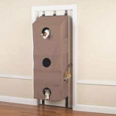 This Door Hanging Cat Condo, without taking up precious space, allows cats to climb, pounce, and lounge all they like.