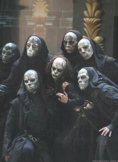 Death eaters...they look like they should be throwing signs or something.