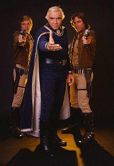 Lieutenant Starbuck, Commander Adama, and Captain Apollo (Dirk Benedict, Lorne Greene, Richard Hatch) from the original Battlestar Galactica (1978).