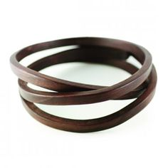 Beautiful walnut bracelet by American designer Gustav Reyes.