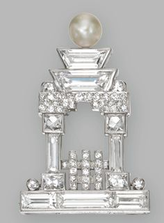 PLATINUM, DIAMOND AND PEARL TEMPLE BROOCH, CARTIER, CIRCA 1925    Of geometric design set with baguette, trapeze-shaped, French-cut and single-cut diamonds weighing approximately 4.50 carats, the top set with a pearl measuring approximately 5.9 mm., signed Cartier, numbered 2939.