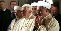 The Pope faces Mecca to pray alongside Turkey's grand mufti, Mustafa Cagrici, at the Blue Mosque