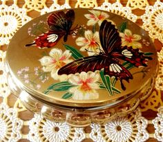 Vintage gold butterfly powder compact. $28.00, via Etsy.