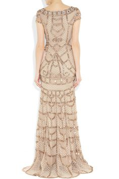 Exquisitely embellished Temperley London Poison gown. This dress features beads, sequins, and diamantes - the perfect dress to make a grand entrance. The scoop neck, cap sleeves & pale pink tulle work