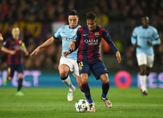 Neymar of Barcelona is closed down by Samir Nasri of Manchester City during the UEFA Champions League Round of 16 second leg match between Barcelona and Manchester City at Camp Nou on March 18, 2015 in Barcelona, Catalonia.