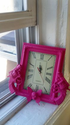 pink gun clock with skull butterfly by CheeseCrafty on Etsy, $27.00