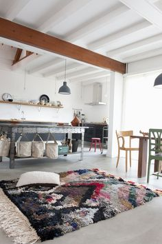 White ceiling with here & there wood.    concrete floor.