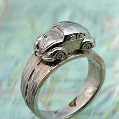 VW BUG RING - Volkwagen Beetle Driving Around Your Finger. Done in Sterling from BandScapes on Etsy.