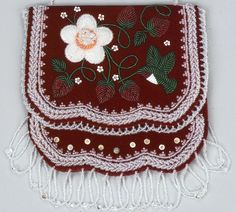 Bag (Detail)  2002  Samuel L. Thomas   (Cayuga)  Detail of beaded bag showing a hummingbird and strawberry pattern. Flowers, berries, and bird are done in the raised beading style typically found in Iroquois beadwork. Fabric on the inside of the bag (not shown) is a strawberry cotton print.