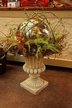 beautiful woodland urn with ferns / twigs / mirror gazing ball