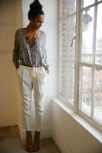 boho chic style translates to work attire  Cream pleated slacks and a flowy blouse go perfectly with a statement necklace...