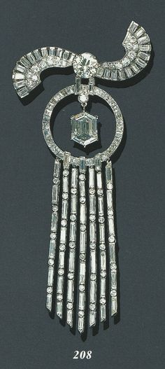 AN ART DECO DIAMOND PENDANT BROOCH, CIRCA Centring upon a hexagonal-cut diamond, suspended by a diamond collet from a calibré-cut diamond independant frame, enhanced by a pavé-set, baguette and circular-cut diamond scroll motif surmount and a seven- Diamond Brooch, Art Deco Diamond, Diamond Pendant, Art Deco Jewelry, Fine Jewelry, Jewelry Design, Art Deco Fashion, Fashion Jewelry, Antique Jewelry