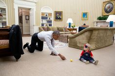 """Nov. 8, 2016 """"The President had just walked in from the dining room and sitting on the floor in the Oval Office was Evelyn 'Evie' Cushman, daughter of Chase Cushman, Director of Scheduling and Advance. He immediately dropped down to his hands and knees and began tossing a ball back and forth with her."""" (Official White House Photo by Pete Souza)"""