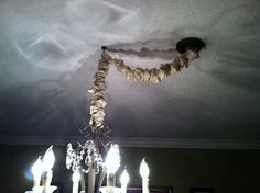 DIY Chandelier cord cover. Use double-sided sticky tape and fabric and fold around the cord, super easy and cheap!