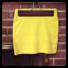 Bandage mini skirt Bandage style mini skirt in a neon yellow/green color. With exposed zipper. Has had good use. Topshop Skirts Mini