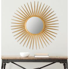 The hand-wrought iron sun flair sunburst mirror feels just as at home in traditional décor as it does in mid-century modern. The elegant artisan-crafted gold finish makes this stunning decorative element shine.