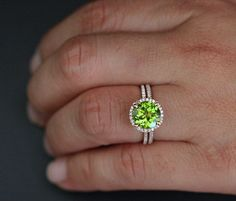 This Stunning delicate and feminine 14k Gold Single Halo Ring Features a flawless Natural Peridot Round measuring 9mm and surrounded with Natural Diamonds. Total Halo Diameter where the Stone is set is approx 12mm. Diamonds go halfway round the band. The Ring can also be worn with a Stacking half eternity Ring. This listing is for the Peridot Ring as well as the Diamond Wedding Band. If you would like any other Gemstone set in this Ring, please convo me. Please read my CUSTOM ORDER Section…