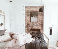 Blush and grey bedroom with exposed brick wall, ikea gjora bed