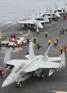 GULF OF OMAN – (June 13, 2013) An F/A-18F Super Hornet assigned to the Black Knights of Strike Fighter Squadron (VFA) 154 waits to launch off of the aircraft carrier USS Nimitz (CVN 68). Nimitz Strike Group is deployed to the U.S. 5th Fleet area of responsibility conducting maritime security operations and theater security cooperation efforts. (U.S. Navy photo by Mass Communication Specialist Seaman Apprentice Kelly M. Agee/ Released)