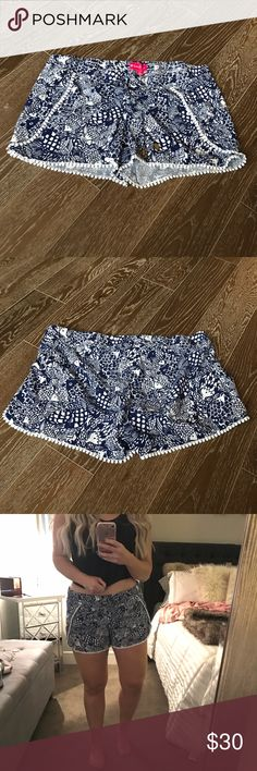 Lilly Pulitzer for Target Pom Pom Shorts Super cute shorts with elastic drawstring waistband and white Pom Pom detail. Worn twice, perfect condition. They are Navy blue and they are a a bit too big for me (you can see in the photo) Lilly Pulitzer Shorts