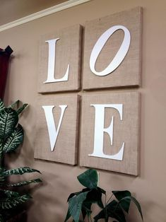 Wrap blank canvases in burlap to create wall art! Love this.