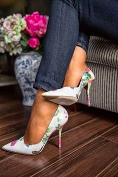 Pointy toe white stilettos with green, sky blue, & pink flowers. Latest trends 2015.