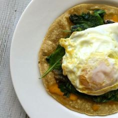 Corn Tortilla with Melted Cheese, Sautéed Baby Greens, Salsa, & Fried Egg