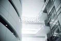 Modern office building interior Royalty Free Stock Photo. Get wonderful discounts on images, illustrations, Videos and music clips at iStockphoto with Coupon.