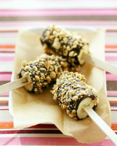 Banana pops? Bananas covered in chocolate rolled in chopped nuts.  Perfect food for a jungle themed baby shower or any party.