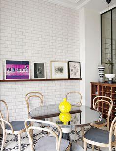Inside an Eclectic Parisian Pad//eclectic kitchen, subway tile, chair rail