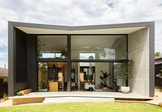 """A garden pavilion designed by Christopher Polly Architect provides a striking counterpoint to a brick bungalow, subverting the physical and conceptual limitations of an """"unapologetically suburban"""" setting. Contemporary Architecture, Interior Architecture, Interior Design, Yellow Brick Houses, Bungalow, Journal Du Design, Pavilion Design, House Extensions, House And Home Magazine"""