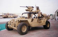 In the spring of 1999 I was working in the UAE and I help man a both at the 1999 International Defense Exhibit in Abu Dhabi, UAE.  When I had a chance I took some photos.  I liked this jeep.