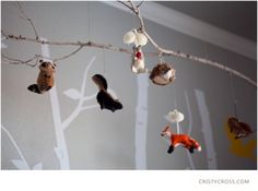 Great idea for a mobile- Christmas ornaments (these are from anthropologist and cold water creek) and sticks!