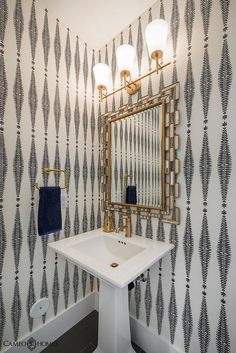 Chic powder room features walls clad in cream and black fern wallpaper, Kelly Wearstler Fern Tree ...