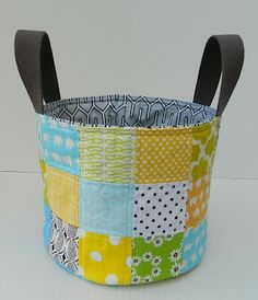 Fabric buckets detour. She links to a site with an actual tutorial for a fabric bucket. I would do these type of handles though, but that's just me. =)