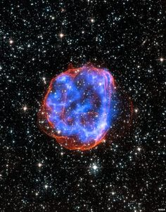 In this image, an expanding shell of debris called SNR is left behind after a massive star exploded in the Large Magellanic Cloud, a satellite galaxy to the Milky Way. Multimillion degree gas is seen in X-rays - NASA/CXC/SAO Cosmos, Hubble Space Telescope, Space And Astronomy, Space Facts, Hubble Images, Star Images, Space Photos, Image Of The Day, Amazing Spaces